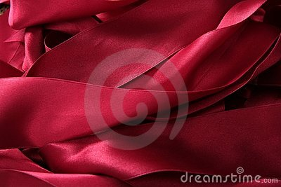 Red satin ribbons in a messy mess texture