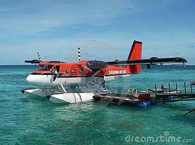 red seaplane anchoring