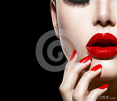 Red Lips and Nails Stock Photo