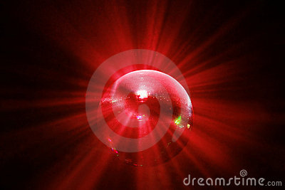 Red shining disco ball in motion