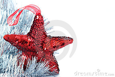 Red shiny star decoration with silver tinsel