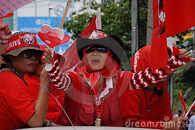 Red SHirt Protestor with heart clapper in hand Editorial Image