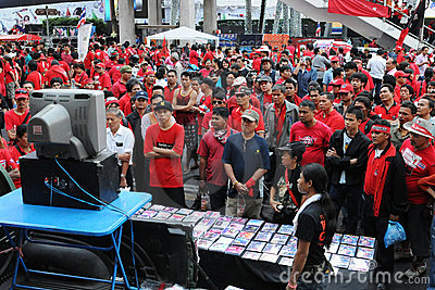 Red-shirts watching a video at a rally in Bangkok Editorial Stock Photo
