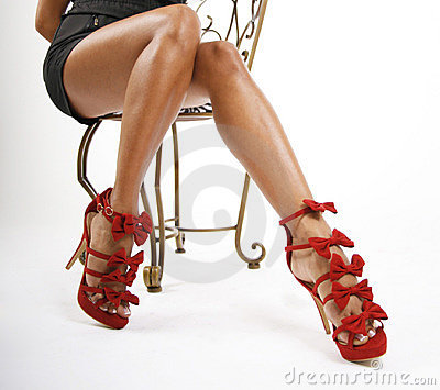 Red shoes on sexy legs