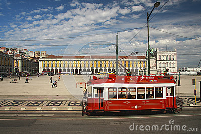 Red sightseeing tram at Lisbon Commerce square Editorial Stock Photo