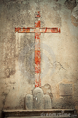 The red sign of the cross on the wall.
