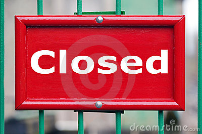 Red sign with the word Closed