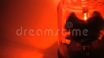 Red Siren spins close up. Stationary red siren spins in the dark. Close up stock video footage