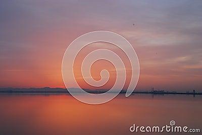Red sky before sunrise at dawn at Tunis lake