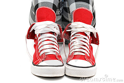Red sneakers over white.