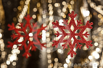 Red snow flake on a gold glitter background