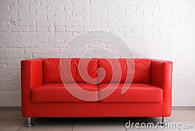 Red sofa and brick wall