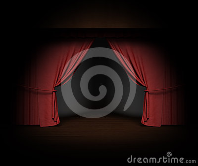 Red stage curtain with spotlight on stage