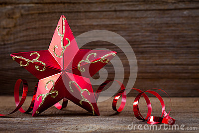 Red star , gifts and ribbons on wooden board