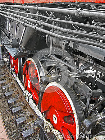 Red steam engine wheel, metal connected pipe,