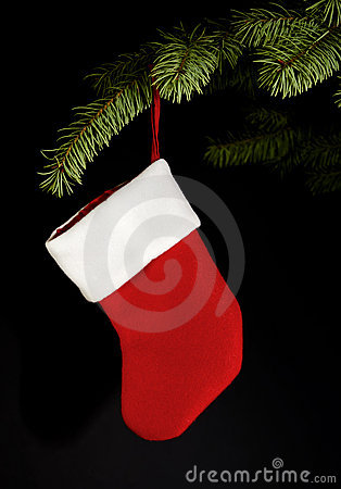 Red stocking hanging from Christmas tree