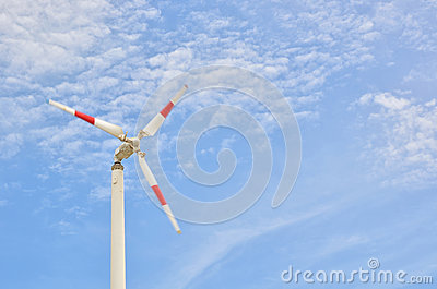 Red strip wind wheel on blue sky