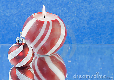 Red striped Christmas candle blue background