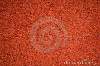 Red stucco textured concrete wall background
