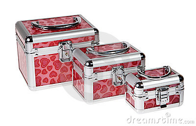 Red suitcase on the white background
