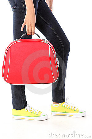 red suitcase and yellow shoes