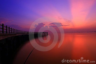 Red sunset over sea and pier