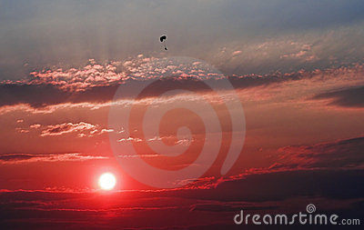Red sunset with paraglider