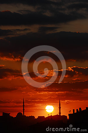 Red sunset scene with mosque and minarets