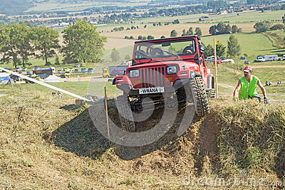 Red SUV at difficult terrain Editorial Stock Image