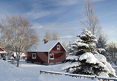 Red Swedish house in winter colors