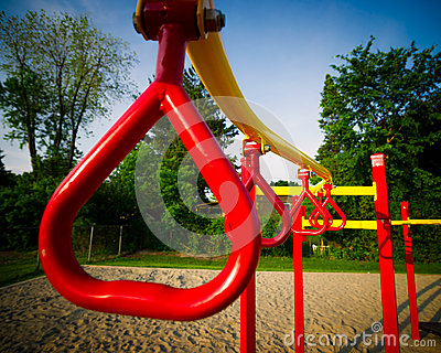 Red Swing Bars on Outdoor Play Structure