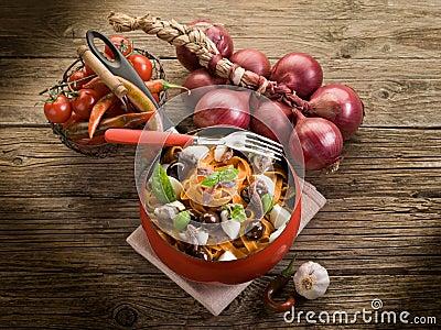 Red tagliatelle with mozzarella