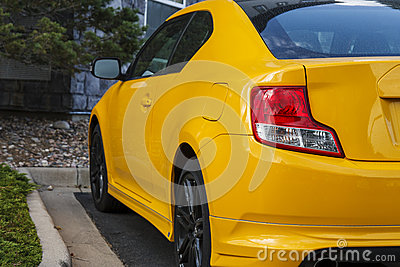 Red Taillight on Bright Yellow Car