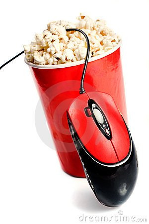 Red tall bowl with popcorn with computer mouse