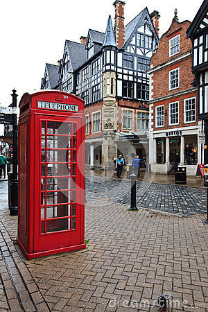 Red telephone kiosk in old part of Chester Editorial Image