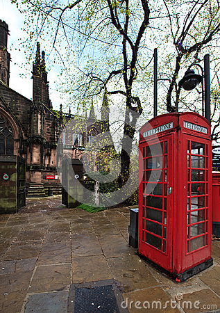 Red telephone kiosk in old part of Chester Editorial Stock Image