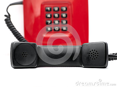Red telephone over white
