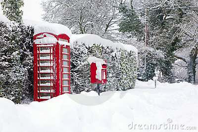 Red telephone and post box in the snow