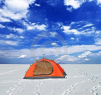 Red tent in a winter plain