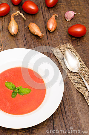 Red tomato cream soup in vertical format
