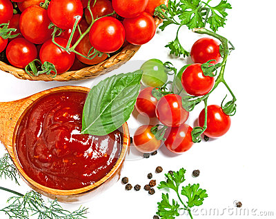 Red tomato sauce in a wooden spoon and ingredients, isolated in white ...