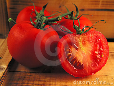 Red tomatoes on wood