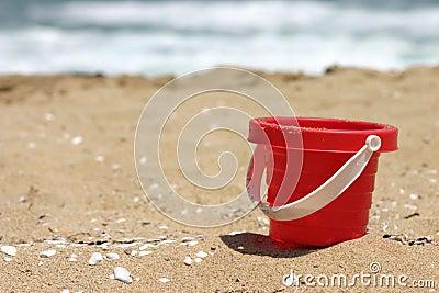 Red toy beach bucket