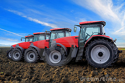 Red tractors on field