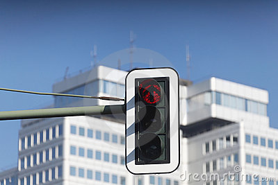 Red traffic light in city