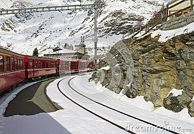 Red train at  Alp Grüm station