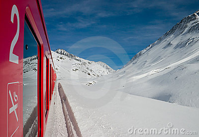 Red train and mountains