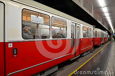 Red tram / trolley car at station: Vienna, Austria Editorial Image