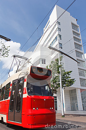Red Tram, White Building