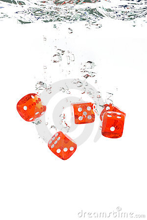 Red Transparent Dice Falling Into The Water Stock Photos